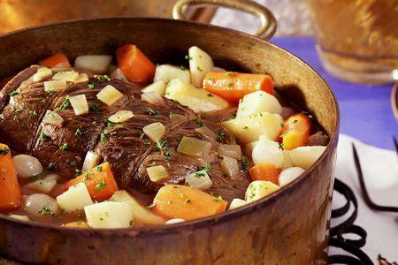 dutch oven with pot roast and veggies
